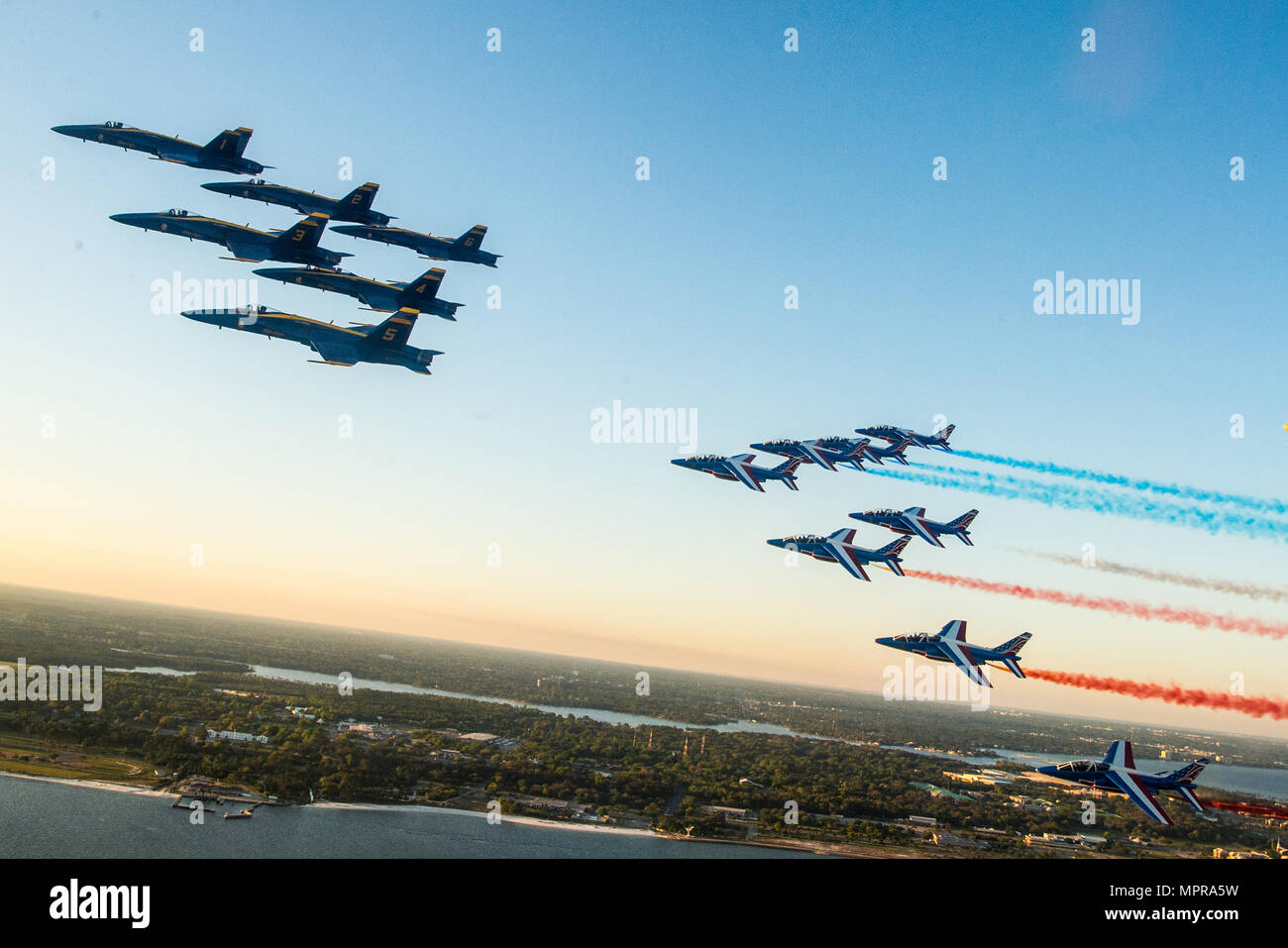 170409-N-ZG607-848 PENSACOLA, Fla. (Apr. 9, 2017) U.S. Navy Flight Demonstration Squadron, The Blue Angels fly in formation with the Patrouille Acrobatique de France enroute to Naval Air Station Pensacola. The Blue Angels are scheduled to perform more than 60 demonstrations across the U.S. in 2017. (U.S. Navy photo by Mass Communication Specialist 3rd Class Dominick Cremeans/Released) - Stock Image