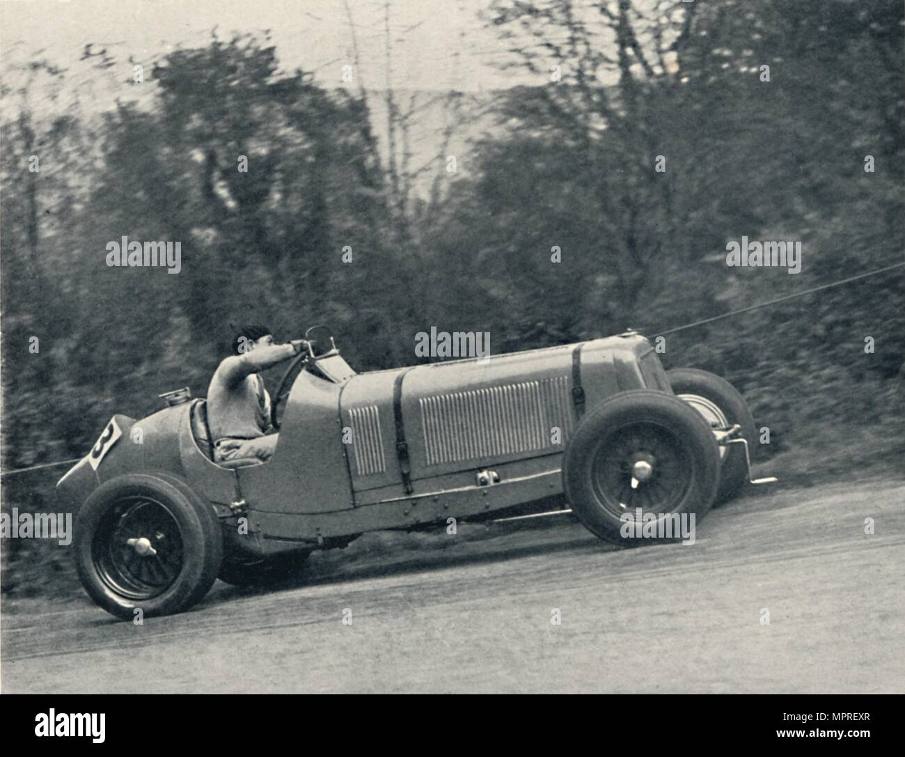 'Raymond Mays (E.R.A.) breaking the record, 1935; the Shelsey Walsh Hill Climb', 1937. Artist: Unknown. - Stock Image