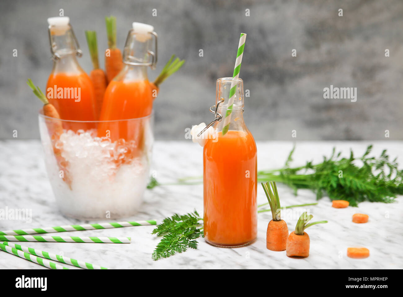 Refreshing carrot juice on marble - Stock Image