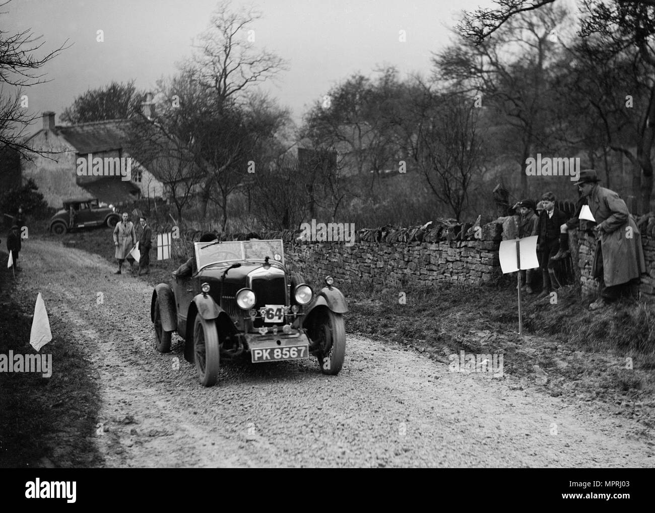 Riley open 4-seater tourer of Hugh Hunter competing in the NWLMC London-Gloucester Trial, 1931. Artist: Bill Brunell. - Stock Image