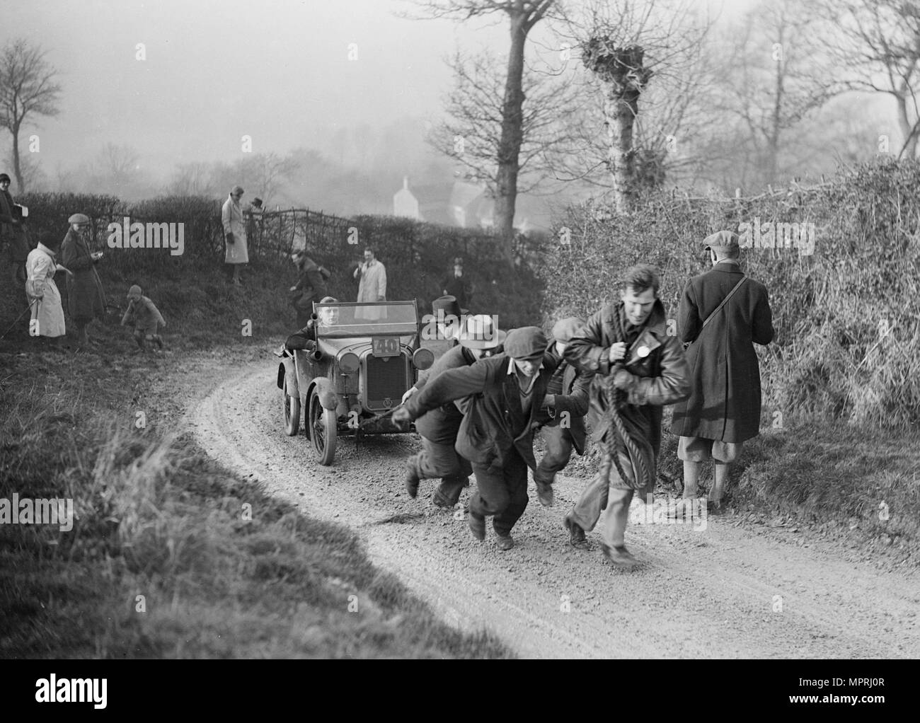 Austin Chummy of CWB Marshall getting a tow at the NWLMC London-Gloucester Trial, 1931. Artist: Bill Brunell. - Stock Image