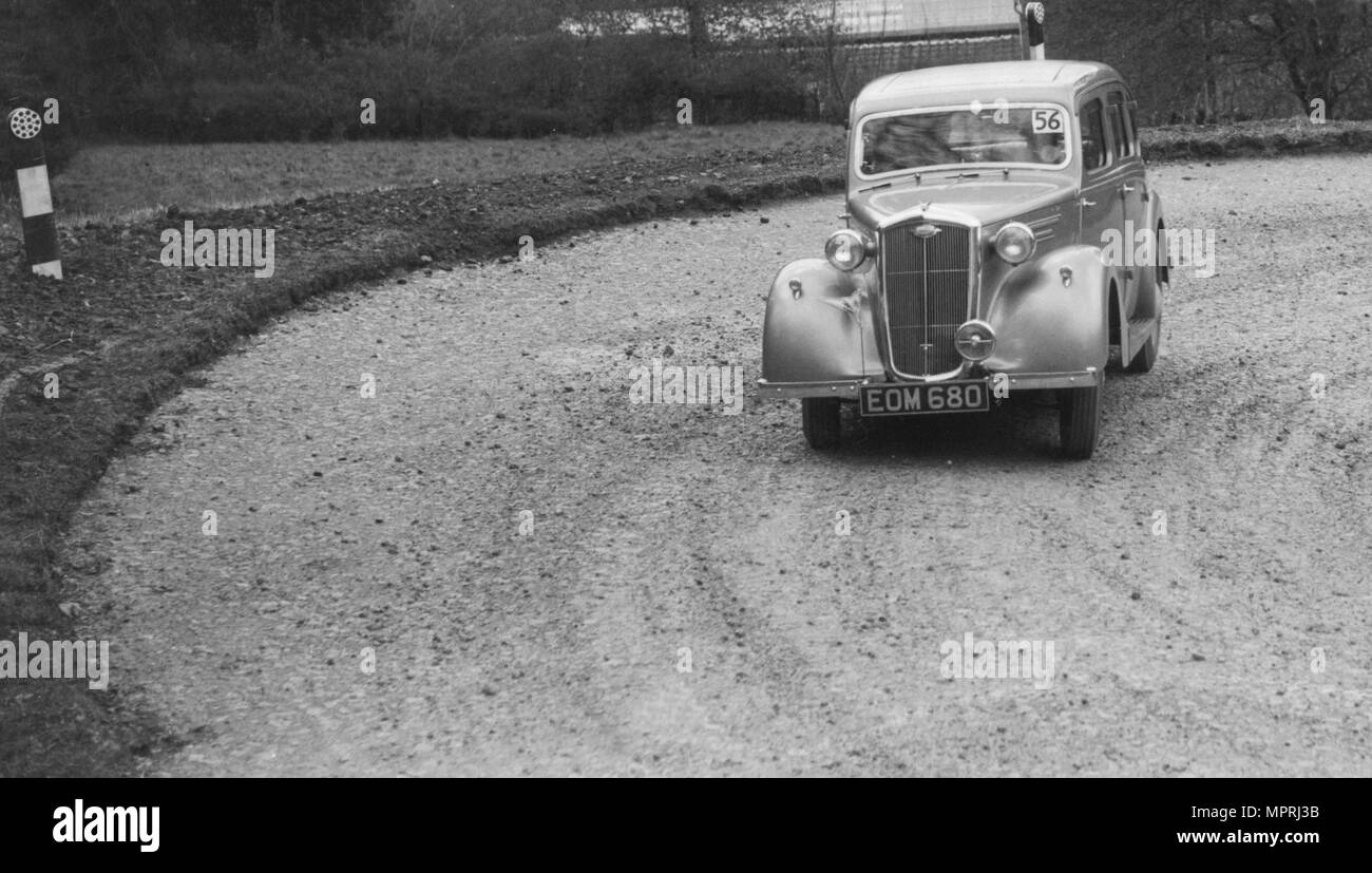 Wolseley saloon of BW Fursdon competing in the RAC Rally, 1939. Artist: Bill Brunell. - Stock Image