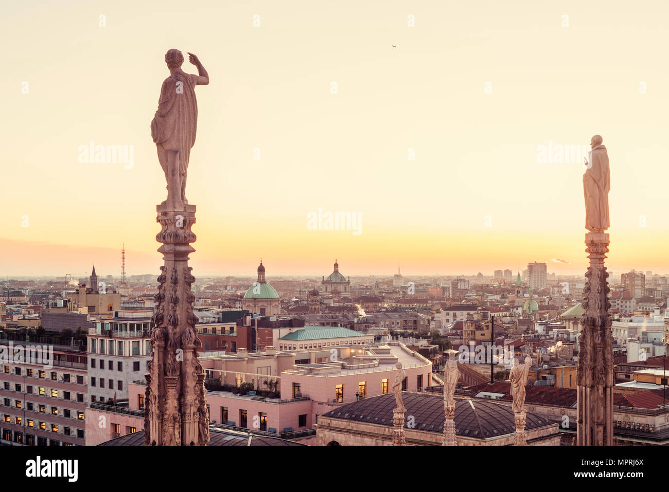 Italy, Lombardy, Milan, statues on the Milan Cathedral at the sunset Stock Photo