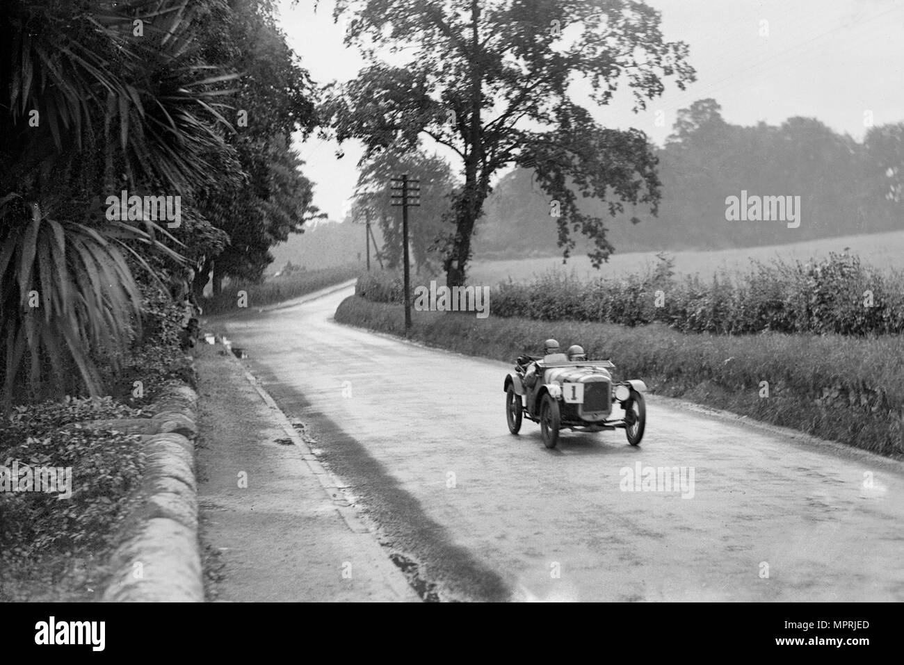 Austin Ulster of Archie Frazer-Nash competing in the RAC TT Race, Ards Circuit, Belfast, 1929 Artist: Bill Brunell. - Stock Image