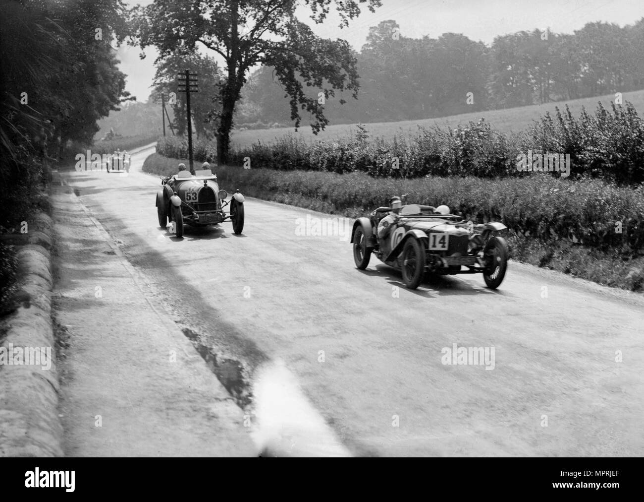 Riley 9 Brooklands of E Maclure and Bugatti Type 43 of JF Field, RAC TT, Ards Circuit, Belfast, 1929 Artist: Bill Brunell. - Stock Image