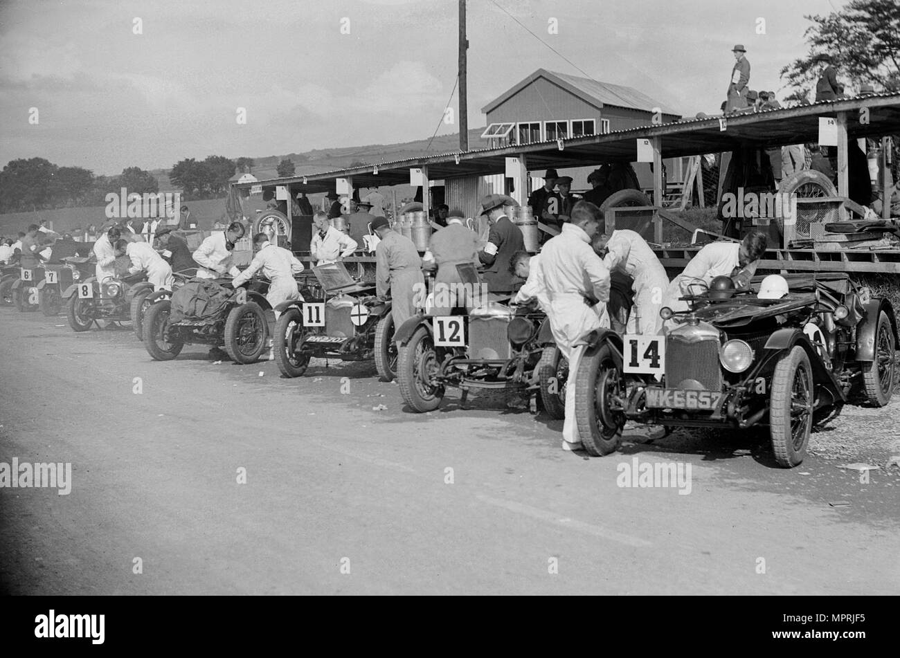 Triumph and Riley cars in the pits at the RAC TT Race, Ards Circuit, Belfast, 1929 Artist: Bill Brunell. - Stock Image