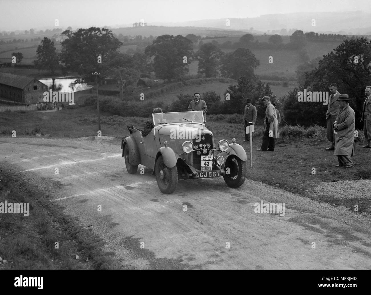 Ford V8 of TC Wise competing in the South Wales Auto Club Welsh Rally, 1937 Artist: Bill Brunell. - Stock Image