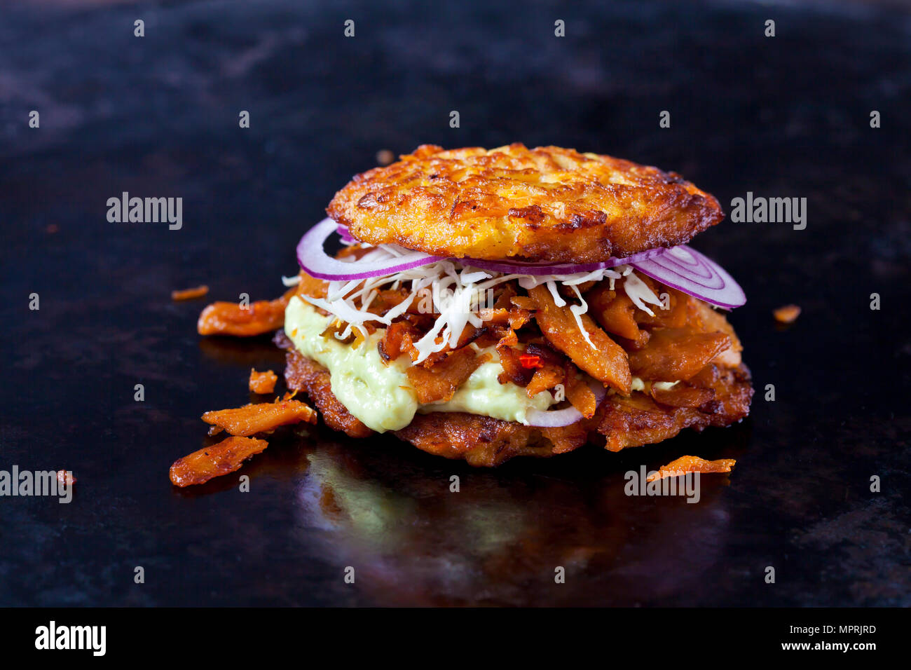 Veggie Burger made of potato fritters,  sweet potatoes, soy meat, remoulade and Barbecue sauce Stock Photo