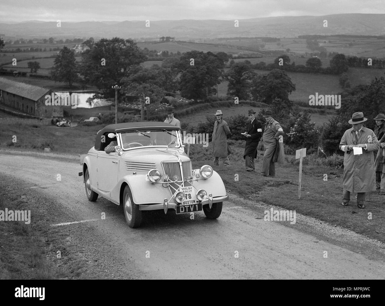 Renault Primaquatre of HC Brownlow competing in the South Wales Auto Club Welsh Rally, 1937 Artist: Bill Brunell. - Stock Image