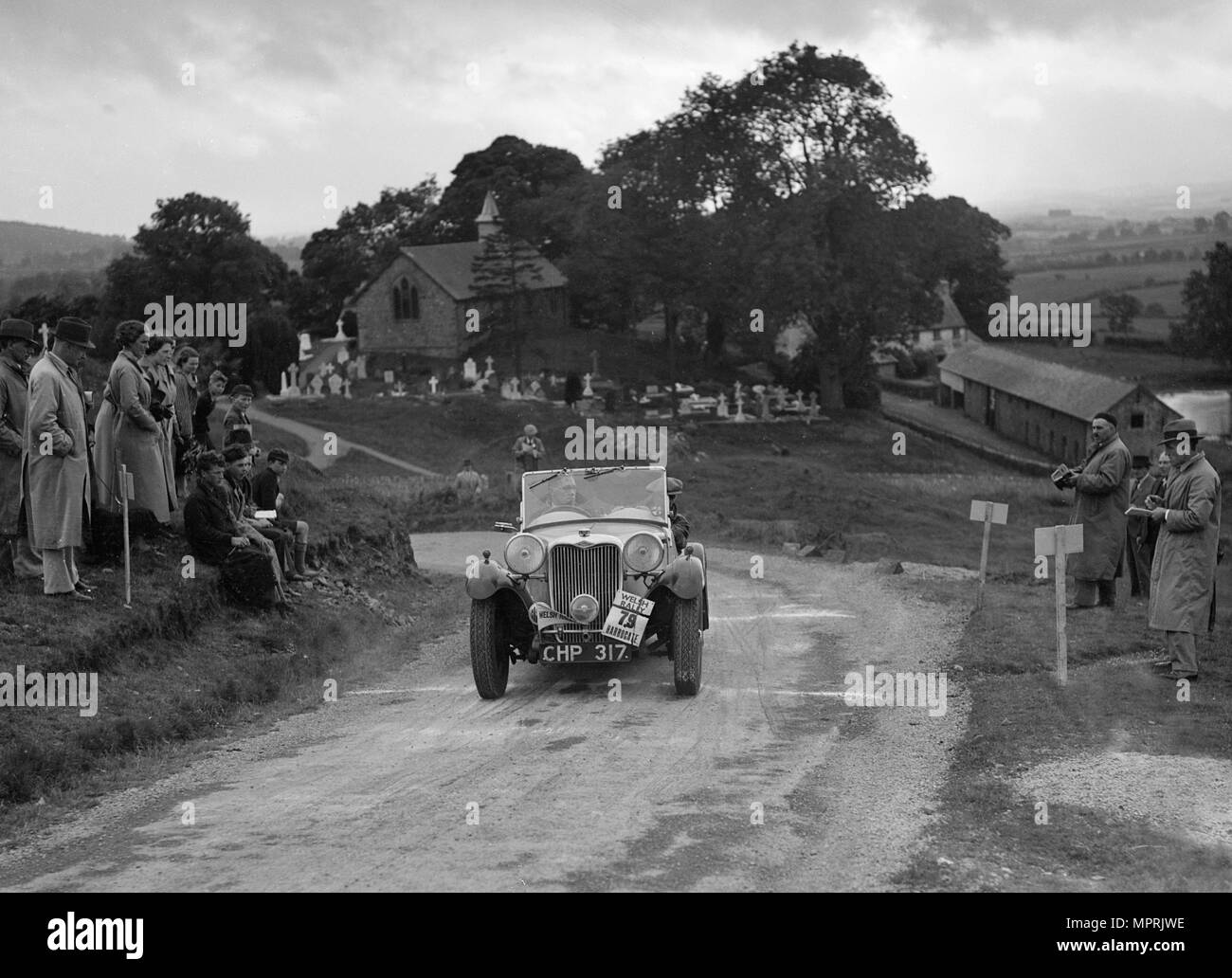 Singer B37 1.5 litre sports of WC Butler competing in the South Wales Auto Club Welsh Rally, 1937 Artist: Bill Brunell. - Stock Image