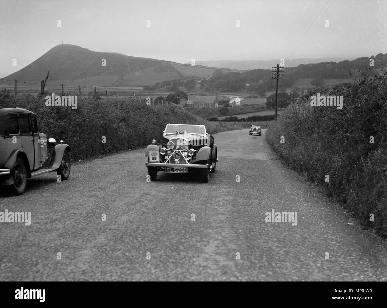 Rover 12/4 of WP Maidens competing in the South Wales Auto Club Welsh Rally, 1937 Artist: Bill Brunell. - Stock Image
