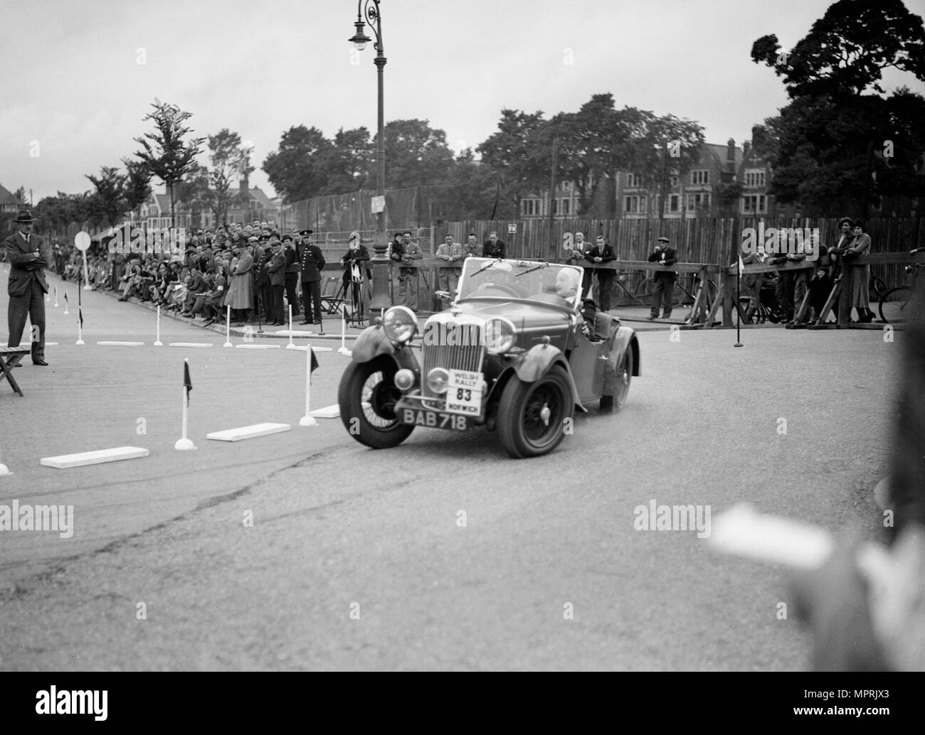 Singer B37 1.5 litre sports of FS Barnes competing in the South Wales Auto Club Welsh Rally, 1937 Artist: Bill Brunell. - Stock Image