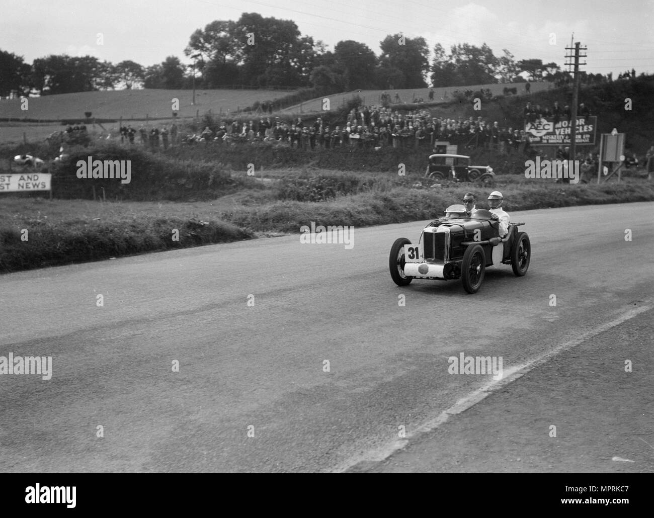 MG C type Midget of Cyril Paul competing in the RAC TT Race, Ards Circuit, Belfast, 1932. Artist: Bill Brunell. - Stock Image
