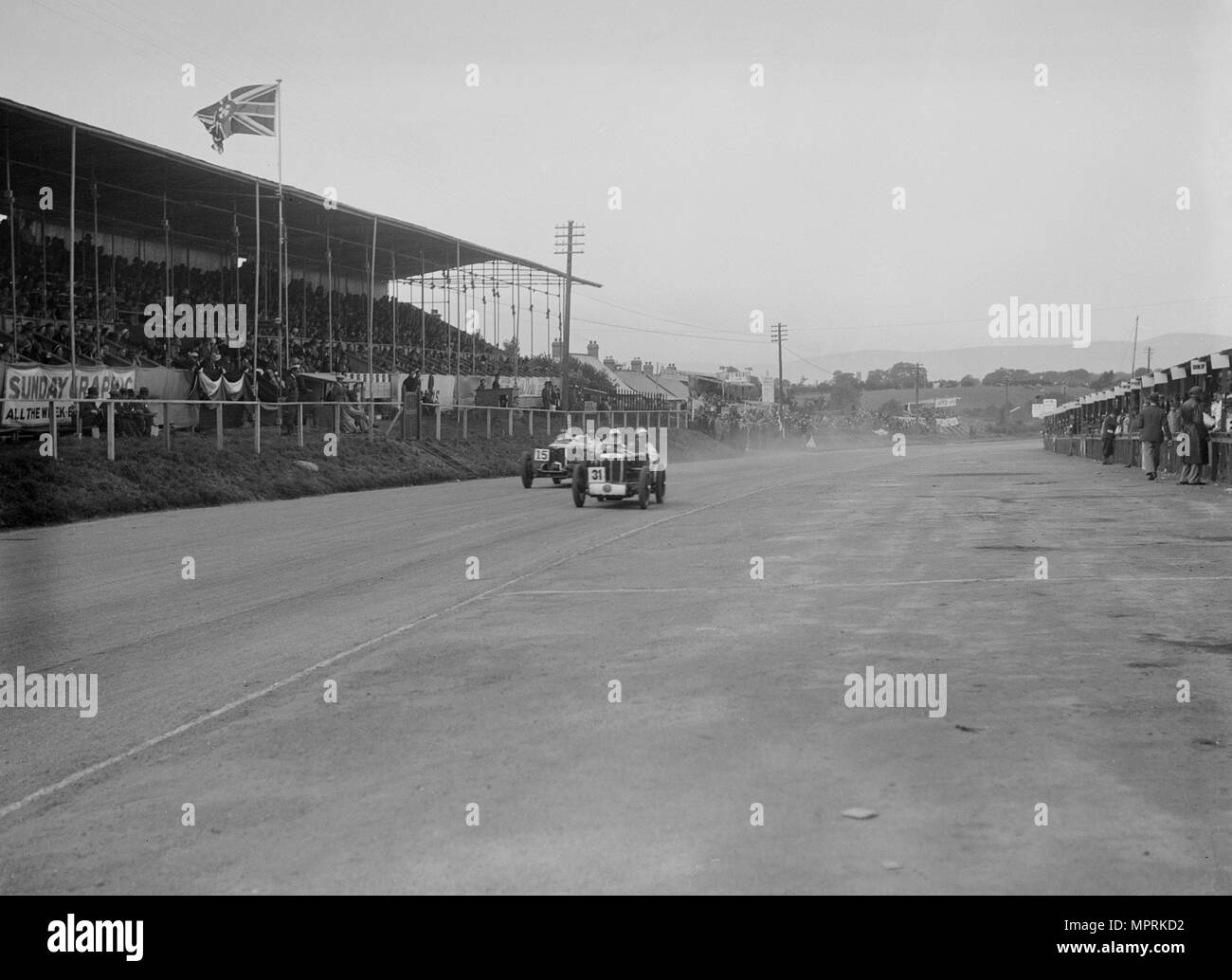 MG C type Midget of Cyril Paul and Riley of Edgar Maclure, RAC TT Race, Ards Circuit, Belfast, 1932. Artist: Bill Brunell. - Stock Image