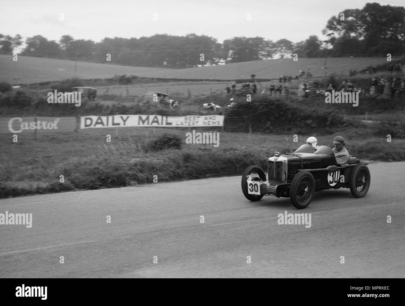 MG C type Midget of Hugh Hamilton at practice for the RAC TT Race, Ards Circuit, Belfast, 1932. Artist: Bill Brunell. - Stock Image