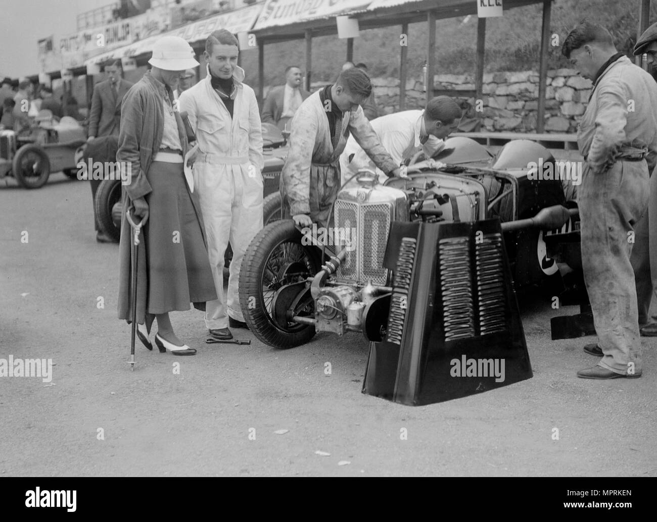 MG C type Midget of Hugh Hamilton in the pits at the RAC TT Race, Ards Circuit, Belfast, 1932. Artist: Bill Brunell. - Stock Image