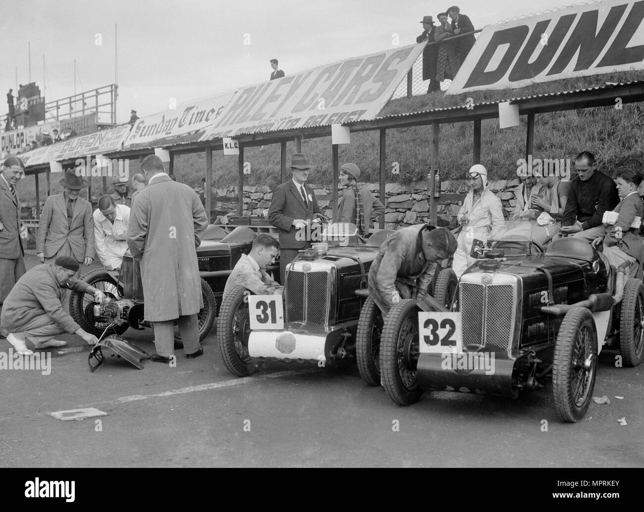 Three MG C type Midgets in the pits at the RAC TT Race, Ards Circuit, Belfast, 1932. Artist: Bill Brunell. - Stock Image
