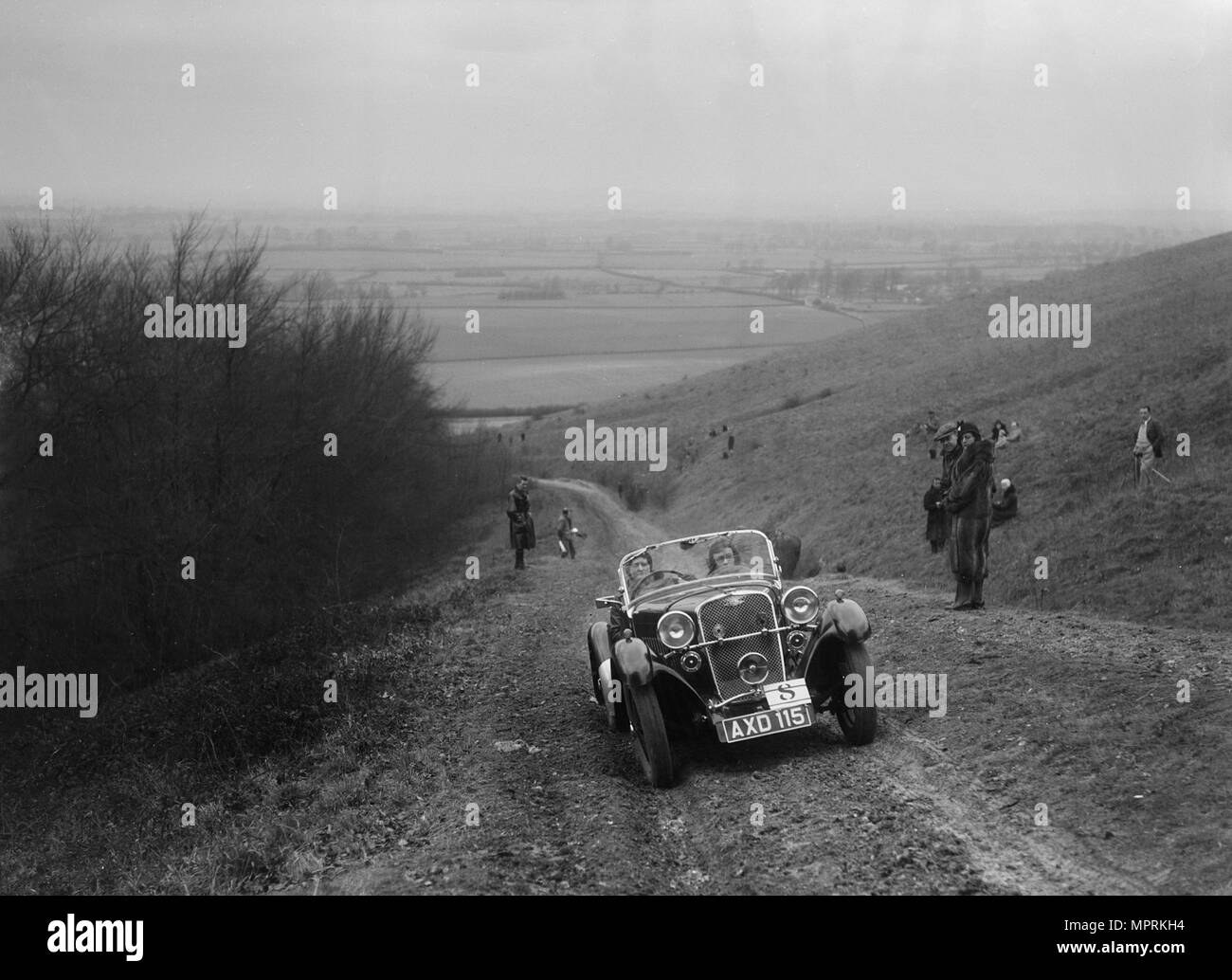 Singer 2-seater sports competing in a trial, Crowell Hill, Chinnor, Oxfordshire, 1930s. Artist: Bill Brunell. - Stock Image