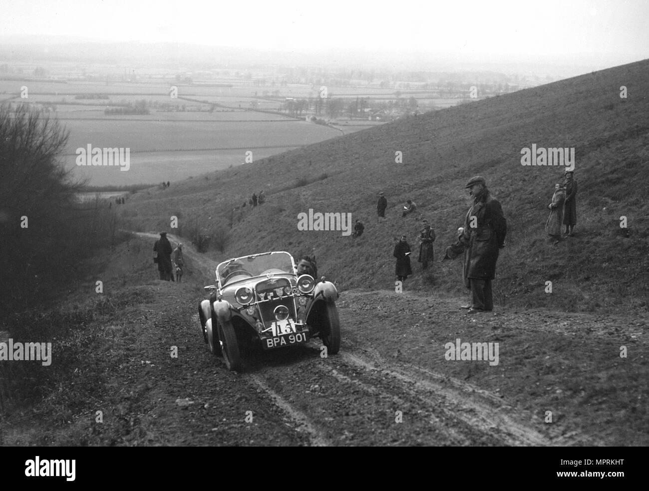 Singer Le Mans competing in a trial, Crowell Hill, Chinnor, Oxfordshire, 1930s. Artist: Bill Brunell. - Stock Image