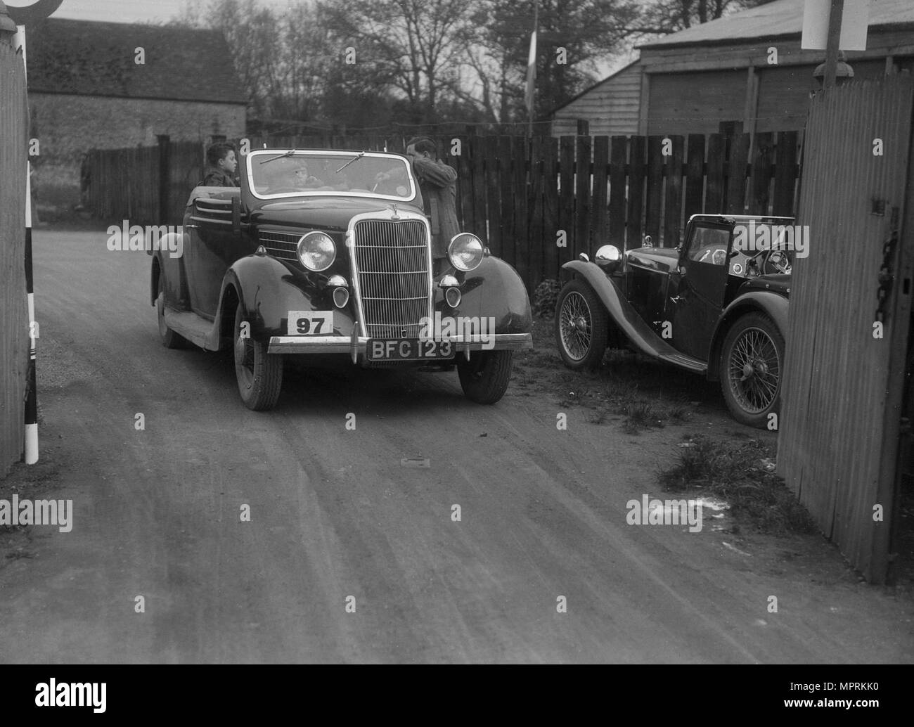 Ford V8 drophead and MG PA at a motoring trial, 1930s. Artist: Bill Brunell. - Stock Image