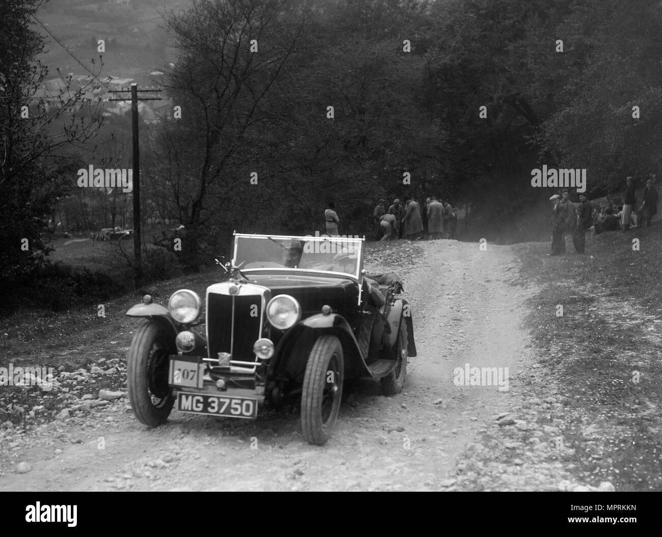 MG Magnette competing in a motoring trial, Nailsworth Ladder, Gloucestershire, 1930s.. Artist: Bill Brunell. - Stock Image