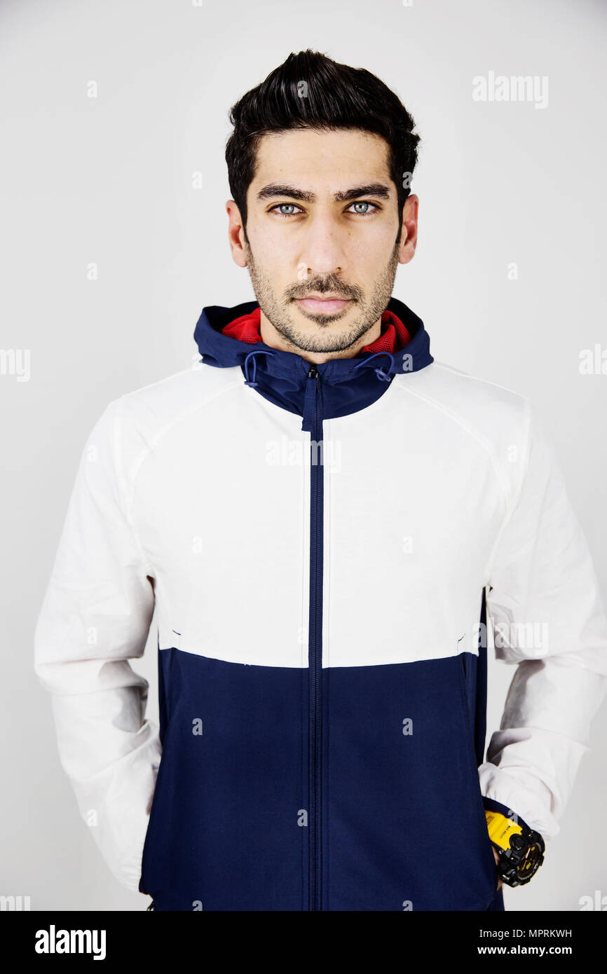 Portrait of young man wearing tracksuit top - Stock Image
