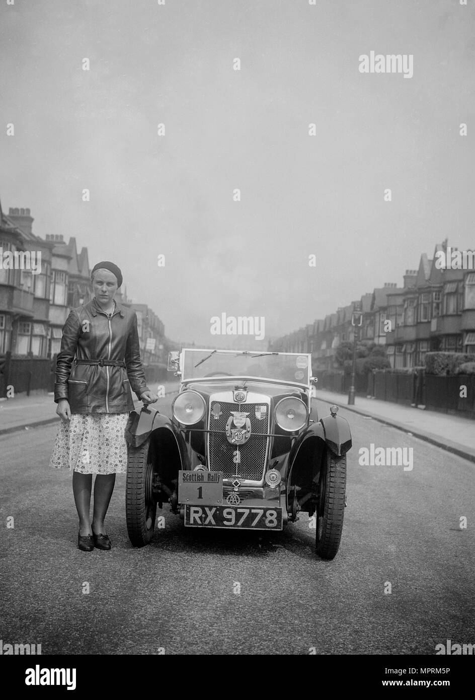 Kitty Brunell with her MG Magna at the RSAC Scottish Rally, 1932. Artist: Bill Brunell. - Stock Image