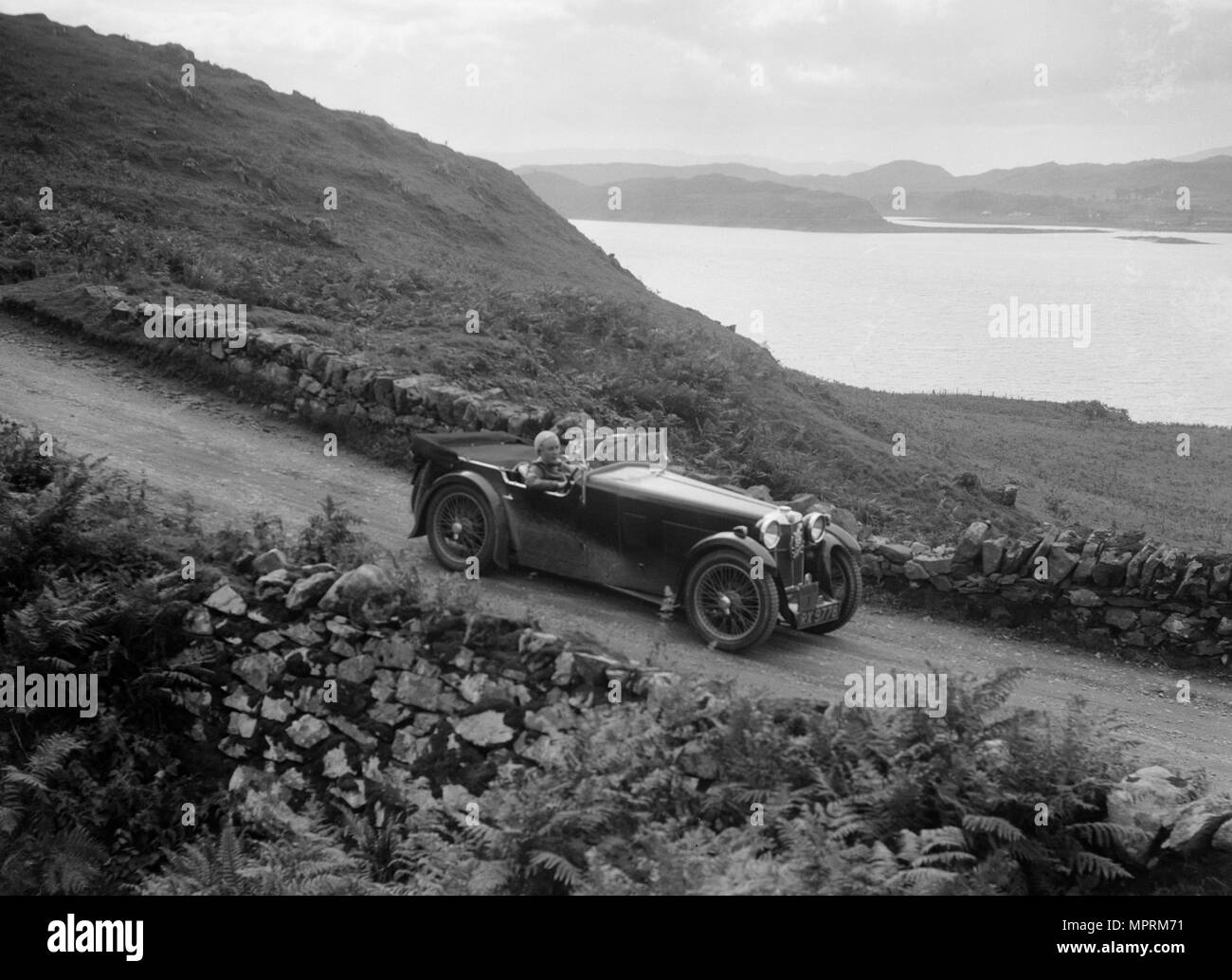 MG Magna of Kitty Brunell competing in the RSAC Scottish Rally, 1932. Artist: Bill Brunell. - Stock Image