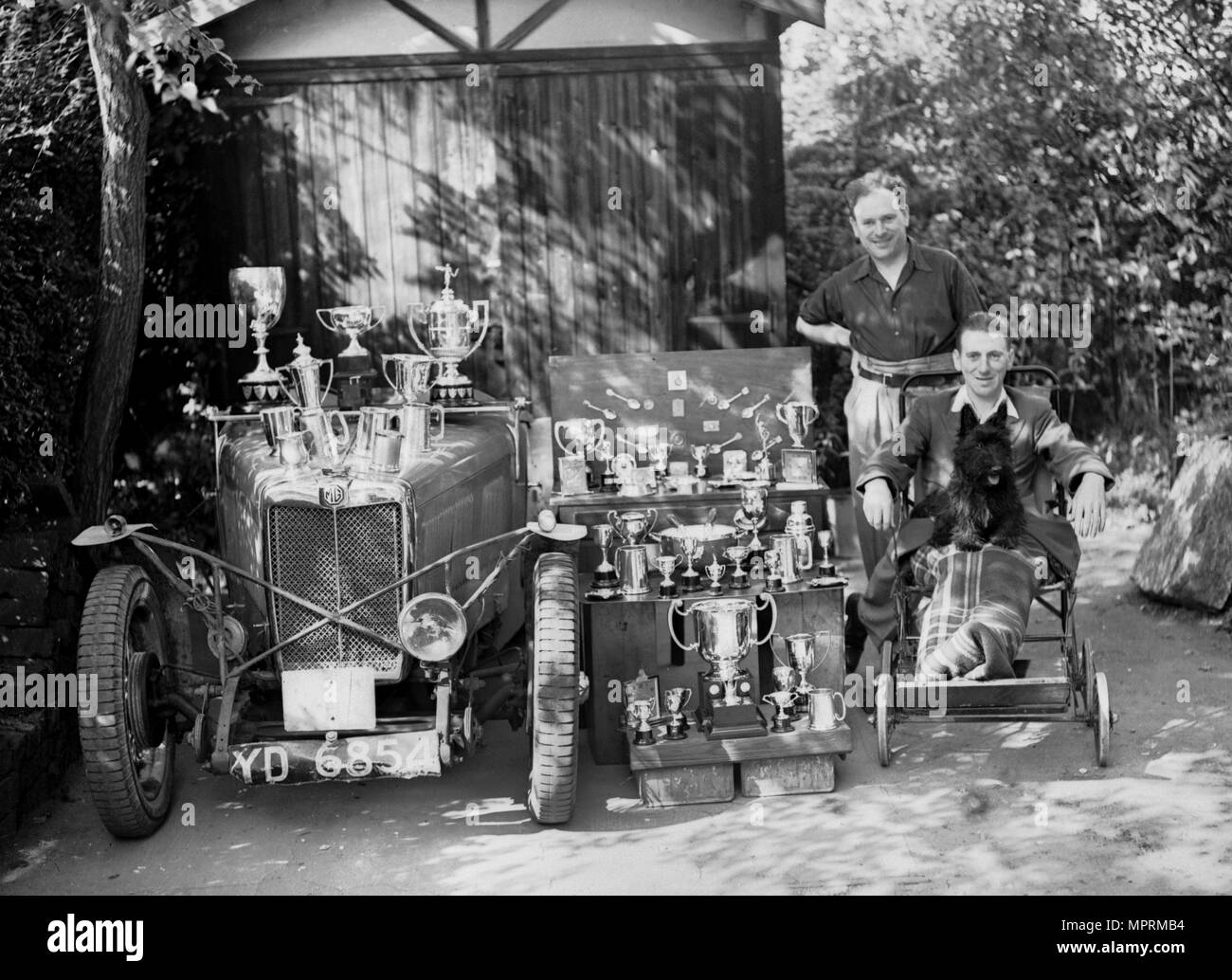 PS Flower with a MG J2 and motoring trophies, 1930s. Artist: Bill Brunell. - Stock Image