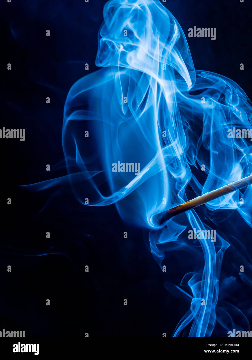 Smoke of blown out matchstick - Stock Image
