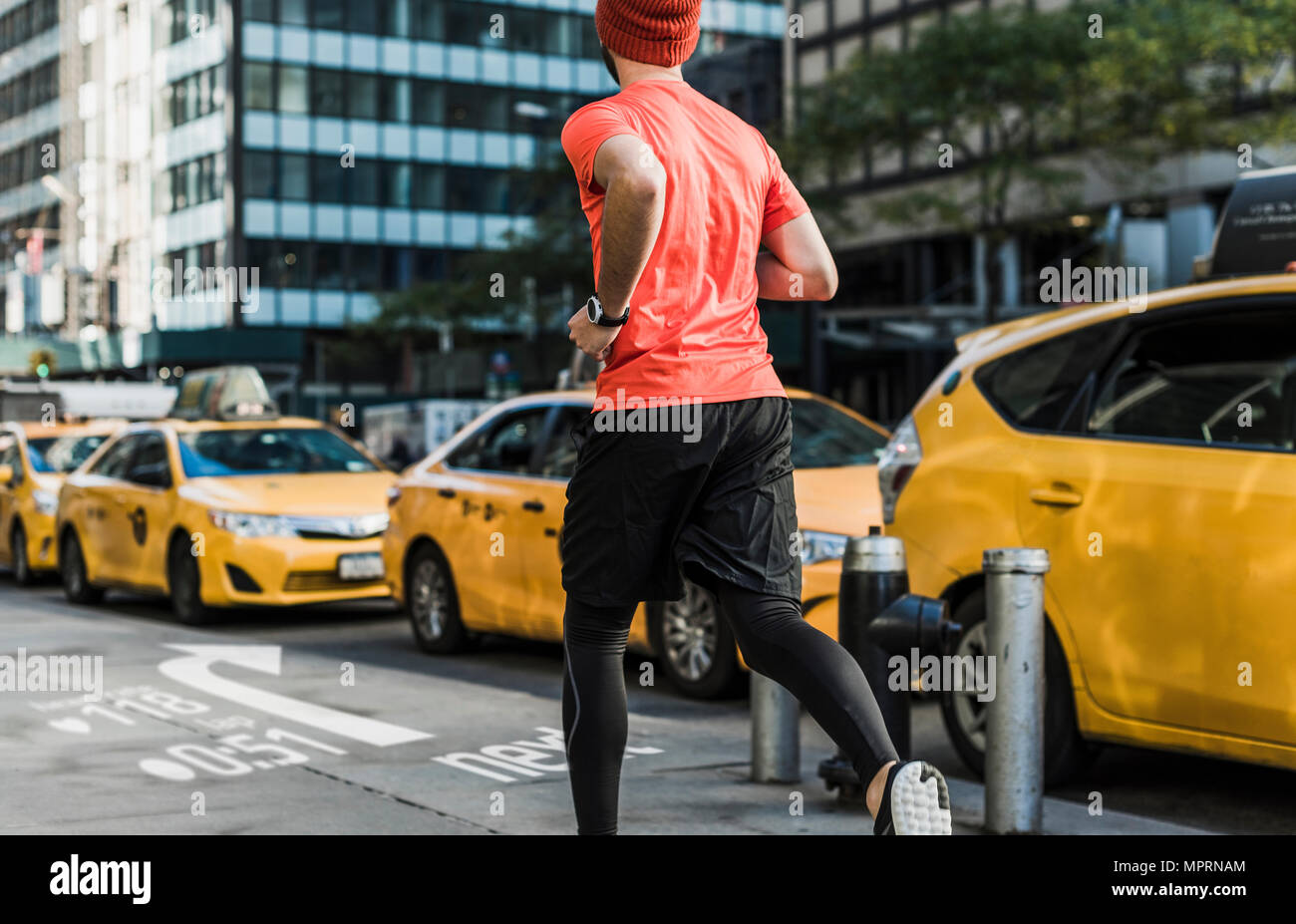 USA, New York City, man running in the city with data on pavement - Stock Image