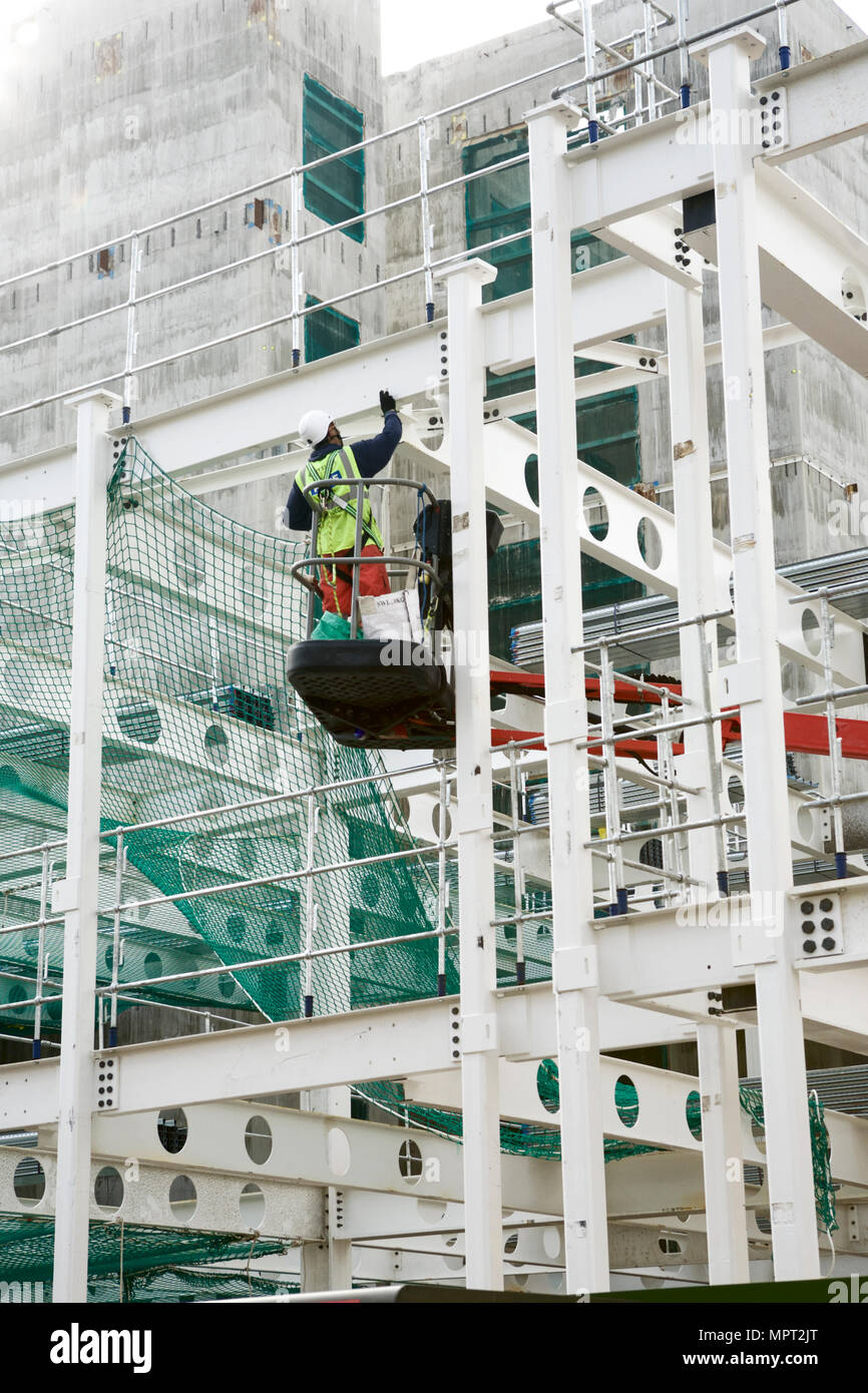 Construction health and safety. Construction worker harness, at the London Fruit and Wool Exchange. Commercial project. Commercial development UK. Stock Photo
