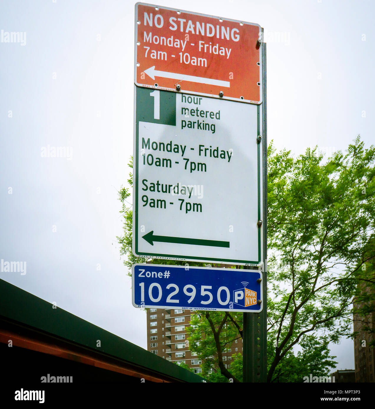 Street signs in the Chelsea neighborhood of New York  inform motorists of the time limitations at the metered parking spots on Thursday, May 17, 2018. The New York Dept. of Transportation announced today that metered parking rates will rise by the end of the year. (© Richard B. Levine) - Stock Image