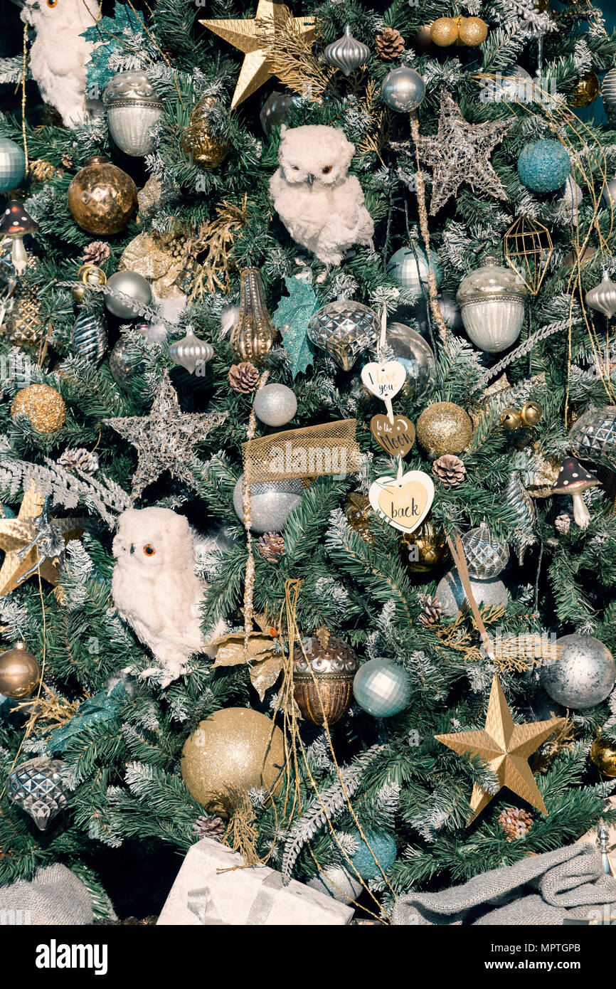 part of decorations on christmas tree with balls stars and owls new years background - Christmas Tree Decorated With Owls