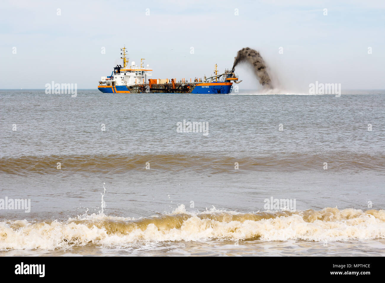 Kijkduin, The Hague, the Netherlands - April 2 2011: Ship pumping sand onto beach for coastal defense - Stock Image