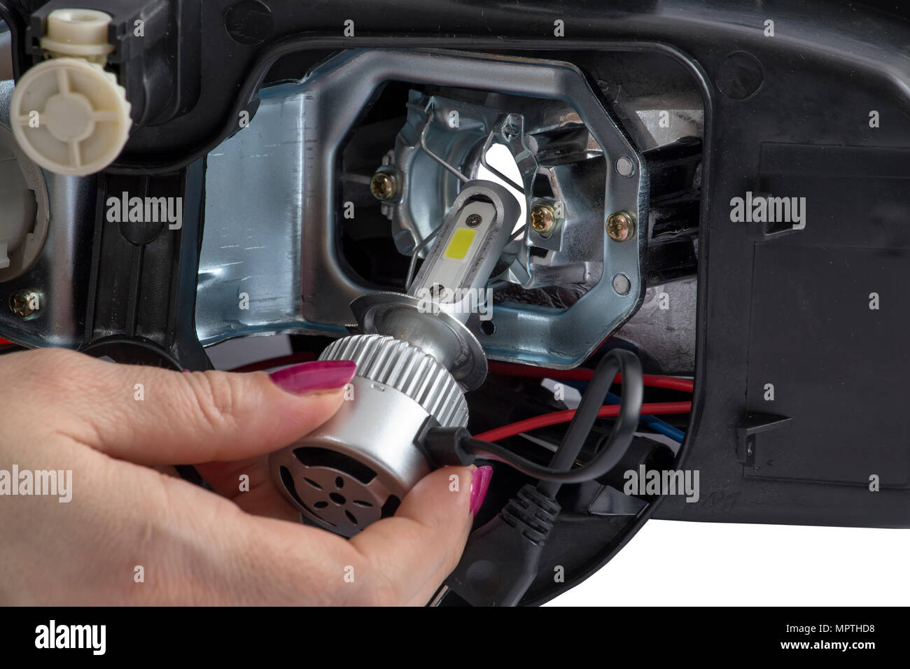 woman hand installing led headlight bulb with wires abstract Car Dimmer Switch Wiring