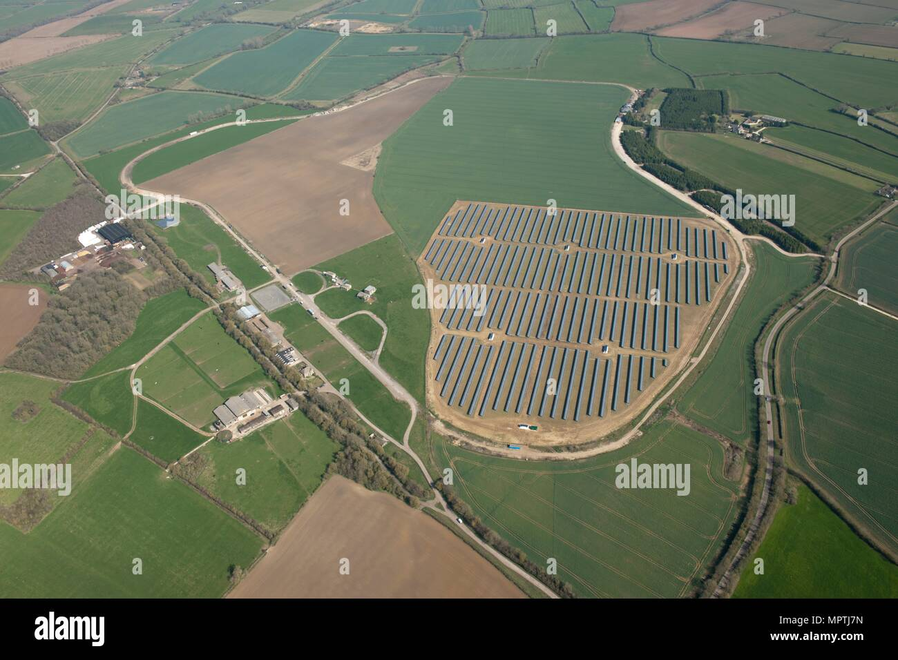 Solar farm on the site of the former RAF airfield, Long Newnton, Gloucestershire, c2010s(?). Artist: Damian Grady. - Stock Image