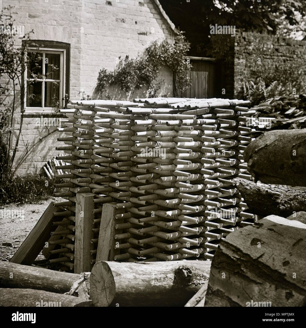 Stack of turned chair legs, Turville, Buckinghamshire, early 20th century. Artist: Unknown. - Stock Image