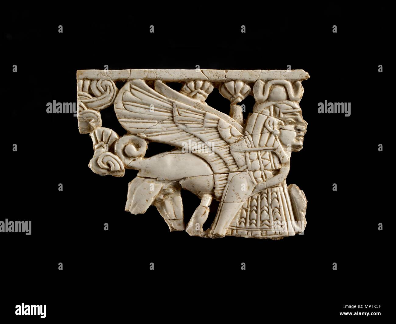 Fragment of openwork ivory panel. Artist: Unknown. - Stock Image