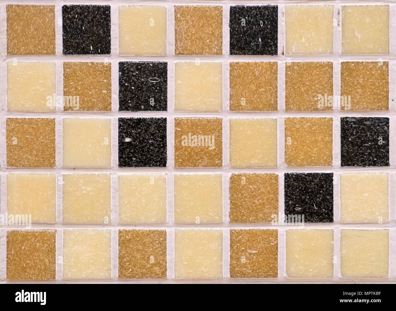 Multi-colored black orange brown and yellow square rough matte ...