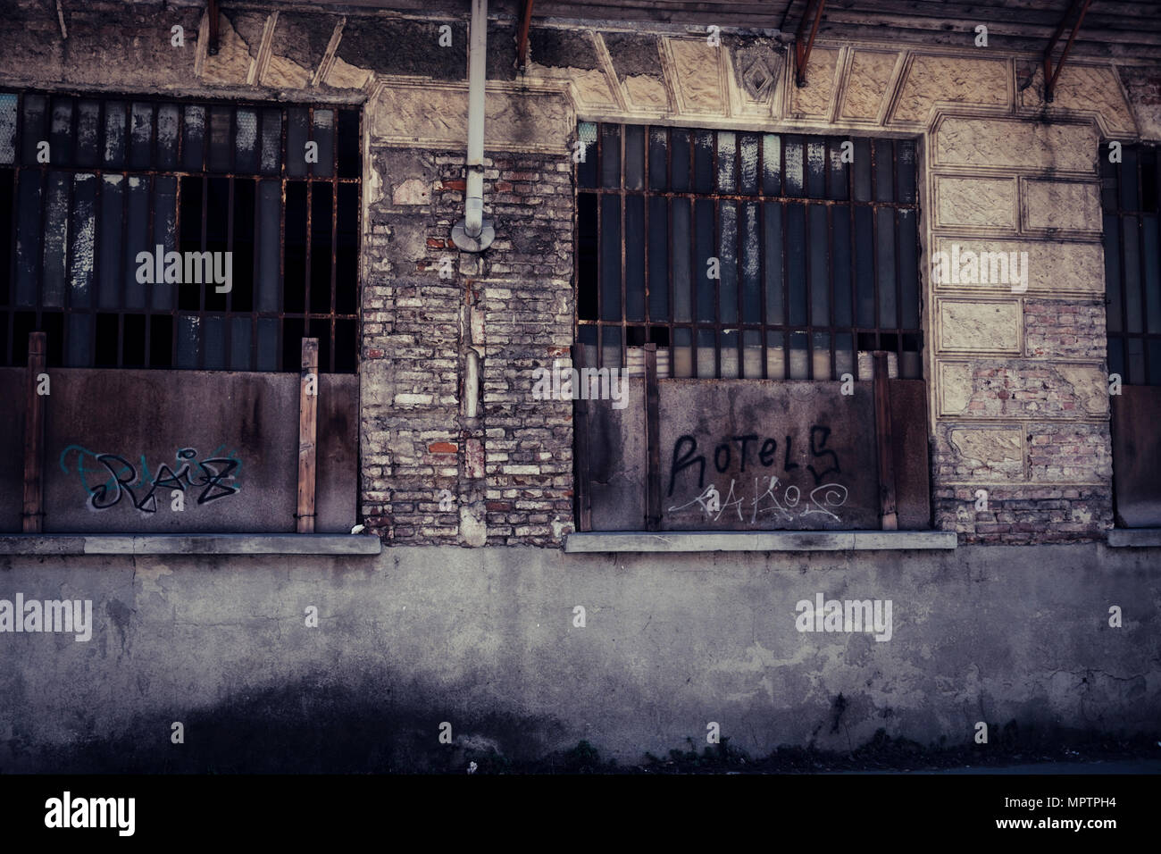 nobody in abandoned place in town. retro dark horror filter and concept. zombie movie style for scary scene. - Stock Image
