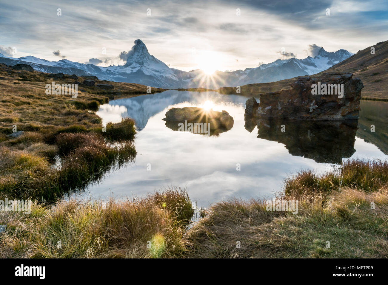 sunset at Matterhorn with reflection in Stellilake in the late afternoon Stock Photo