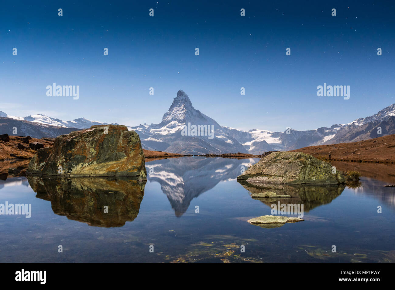 sunset at Matterhorn with reflection in Stellilake in the late afternoon - Stock Image