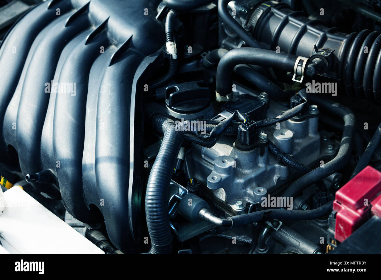 Close-up picture of automobile engine devices, manifold and hoses Stock Photo