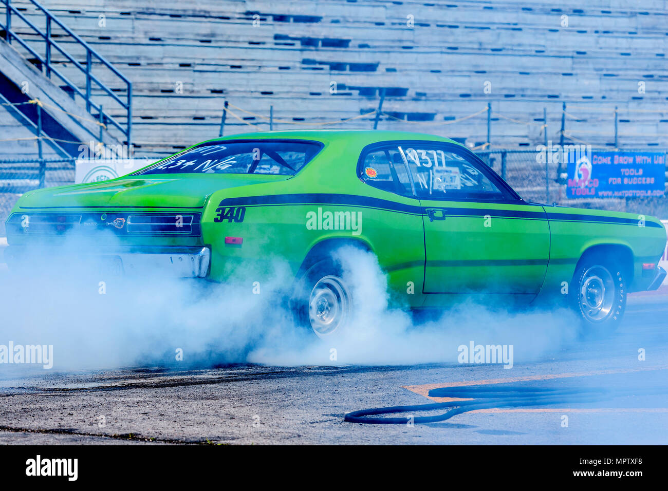 Muscle Car Performing A Burnout At Racetrack Stock Photo 186173772