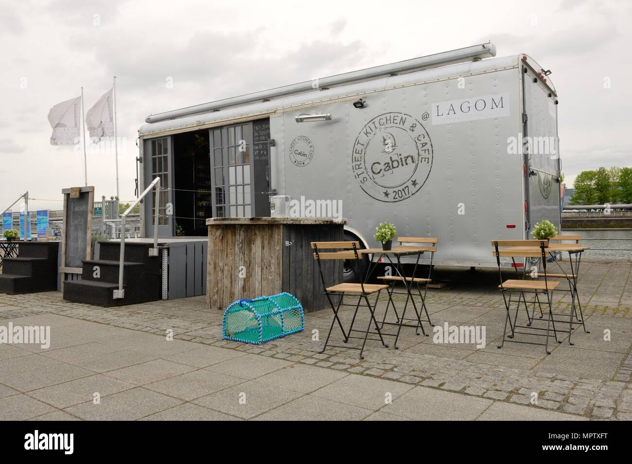 A Lagom Kitchen, Street Kitchen and Cafe Cabin with tables and chairs at Pacific Quay in Glasgow, Scotland, UK - Stock Image