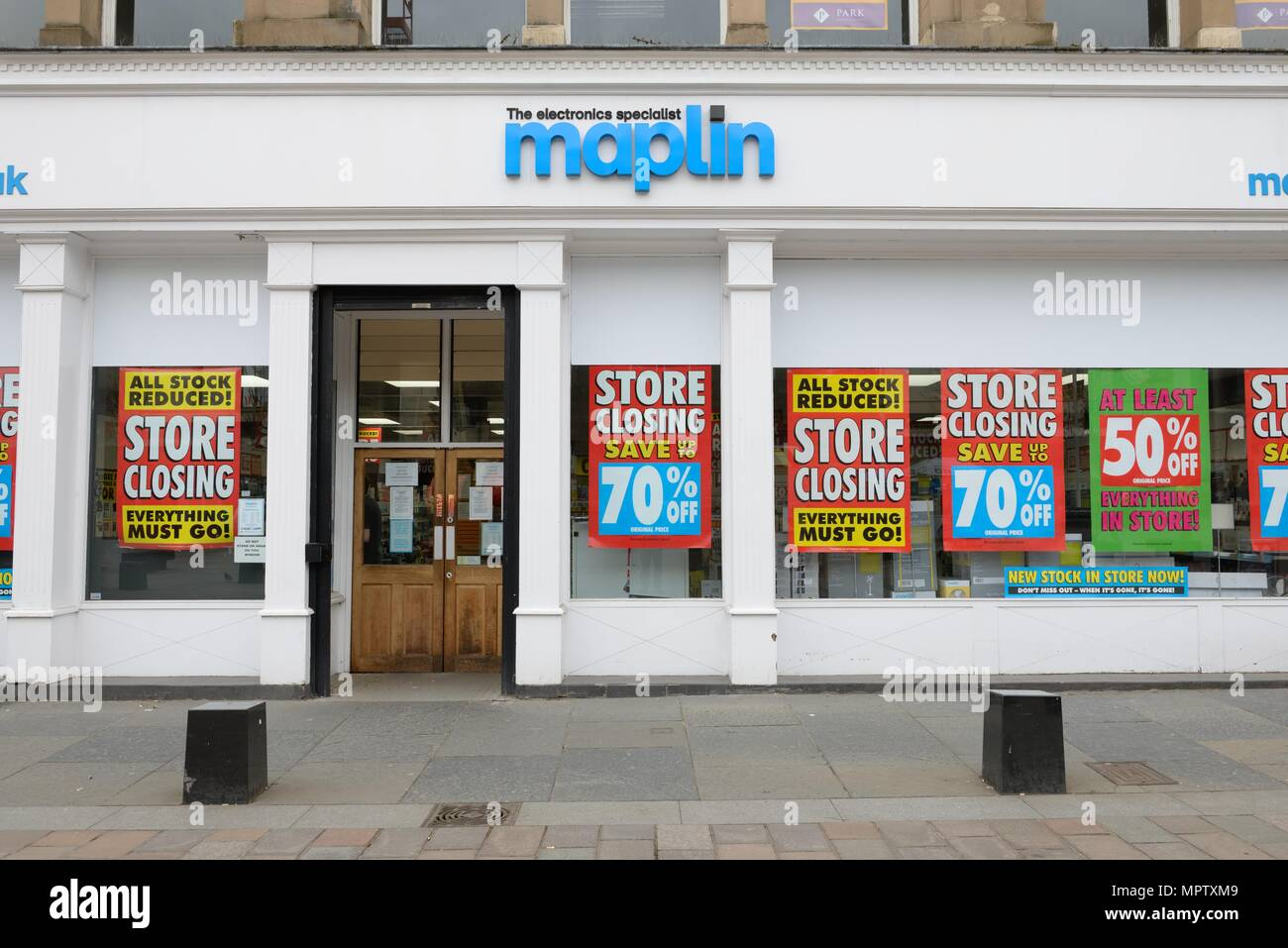 Maplins electronics specialist store showing 'Store closing' reduction posters in shop windows in St Enoch Square, Glasgow, Scotland, UK - Stock Image
