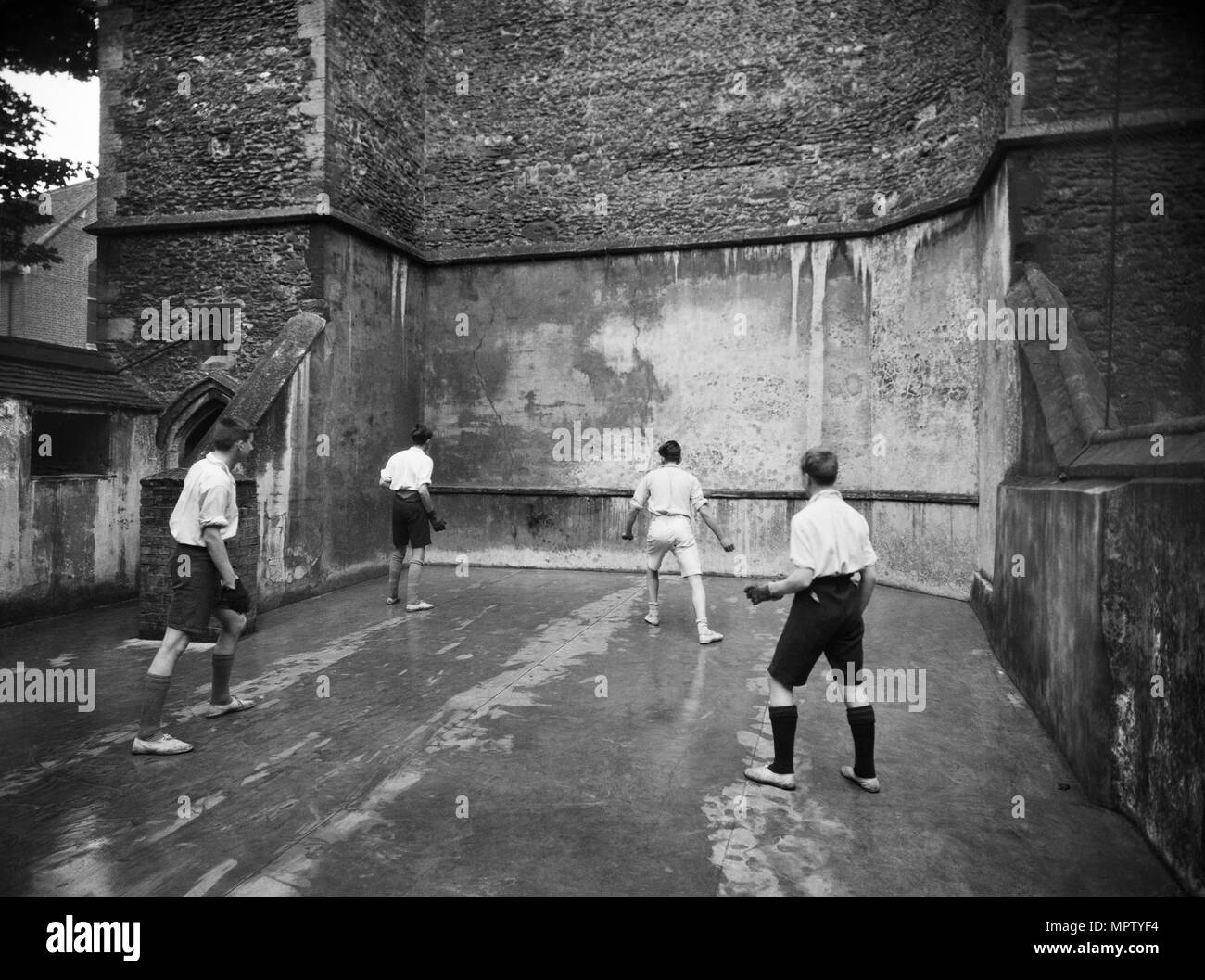 Playing fives, King's School, Ely, Cambridgeshire, 1920-1939. Artist: Marshall Keene and Company. - Stock Image