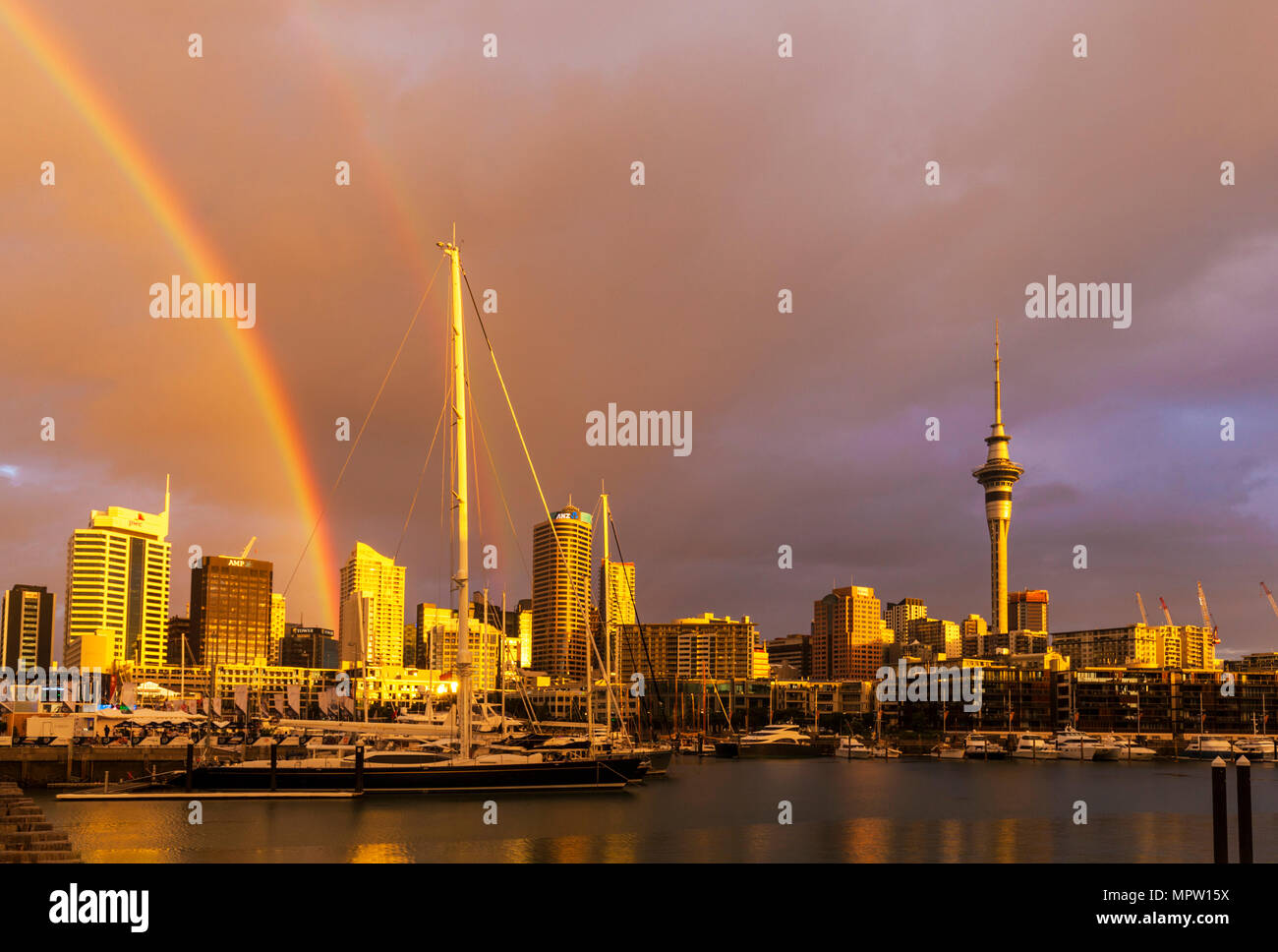 new zealand auckland new zealand north island rainbow after rain storm over auckland harbour waterfront weird colour sky stormy sky auckland nz Stock Photo