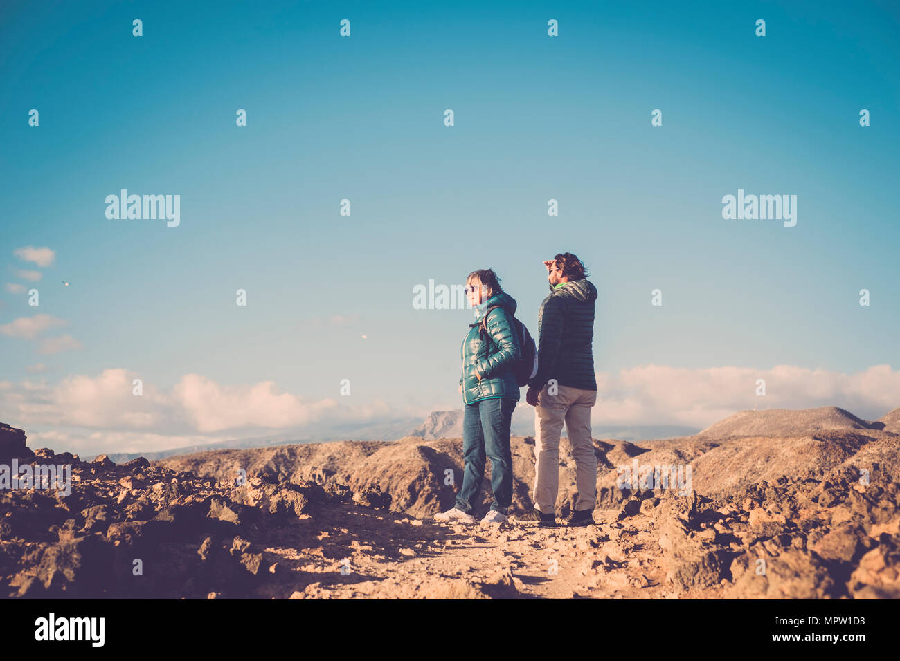 Senior mother and 45 year old son spend time together walking on an isolated path - Stock Image